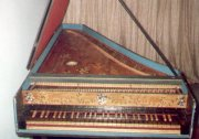 "One-manual harpsichord built by Roberto de Regina (Rio de Janeiro - 1973) known as ""cravo dos leões"" [""lions' harpsichord""] because of the painting of four such animals on its soundboard.  It was Marcelo's first harpsichord - given to him by his father in 1973"